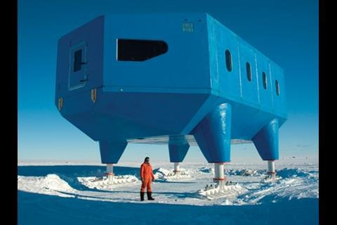 British Antarctic Survey's project manager Karl Tuplin stands outside the first fully clad module at the end of the first construction season.